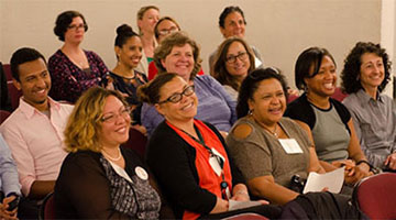 Engaged audience at a career development workshop
