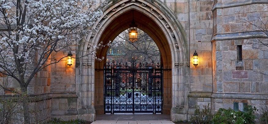 Harkness memorial gate at dusk.