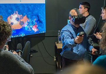 Individuals test mixed reality project prototypes.