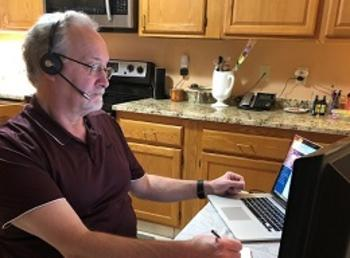 Bob Haig provides Help Desk support from his home