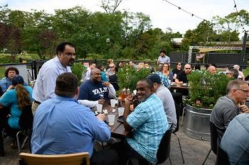 Staff enjoy networking over great food at the IT summer picnic