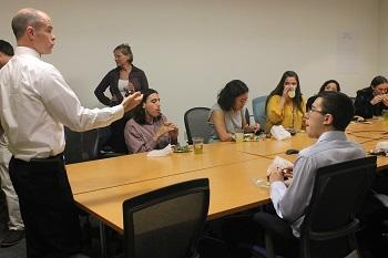 Interns enjoy lunch and lively conversation with John Barden