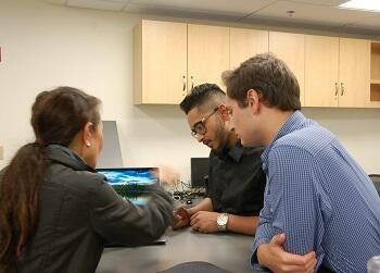 Jacob Corolla and Taslim Uddin helping a Yale employee