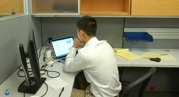 Vince Li hard at work at the computer