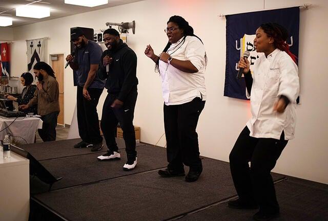 Staff sings karaoke