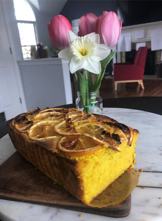 Marisa Figueira's Lemon Cake and some fresh flowers from her yard.