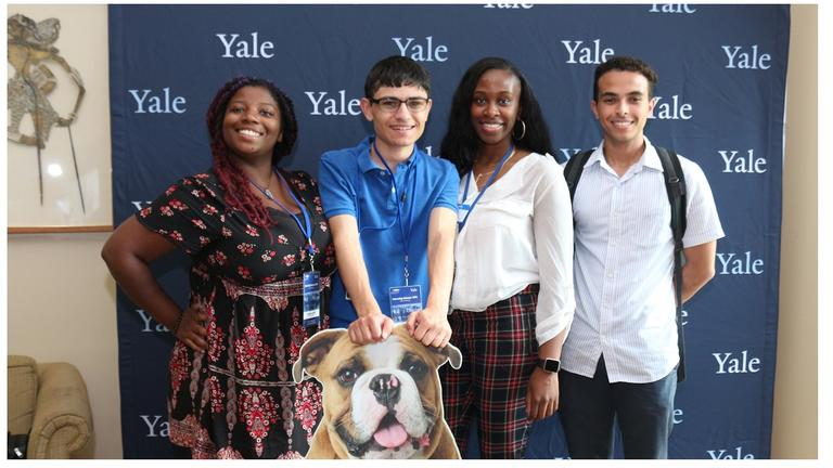 Yale University Library interns pose with Handsome Dan