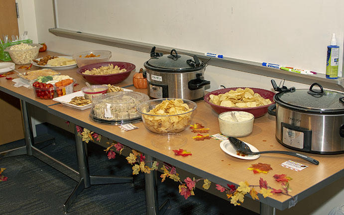 A table featuring some of the food and snacks at the pot-luck.