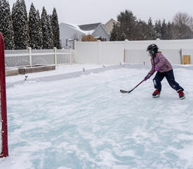 Robert DeSanto, Internal Communications, captured daughter Rylee shooting pucks on her home ice rink.