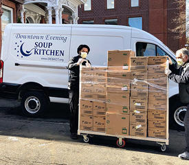 workers prepare to deliver food to soup kitchen