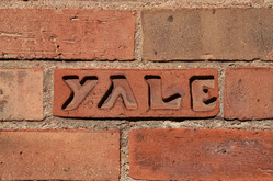 'Yale' carved into brick.